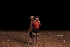 These 10 Orphan Boys Chose To Share The Little Food They Have With 10 Dogs