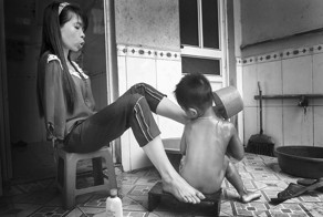 After The War: Vietnamese Girl Born Without Arms Lives Normal Life And Takes Care Of Her Nephew